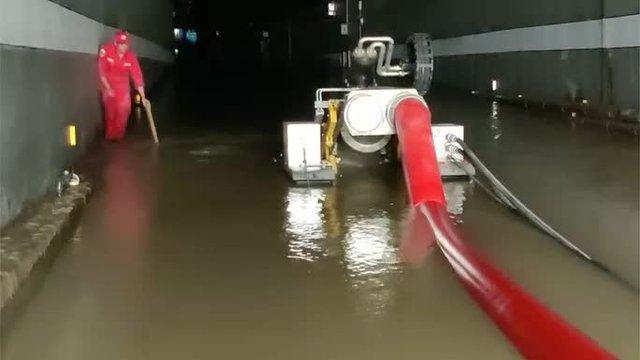 Bi kịch bên trong đường hầm Trung Quốc bị mưa lũ nhấn chìm - Ảnh 6.
