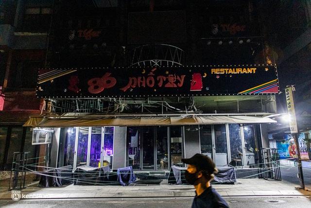 Ảnh: Đường phố Sài Gòn sau 18h vắng lặng như thế nào? - Ảnh 6.