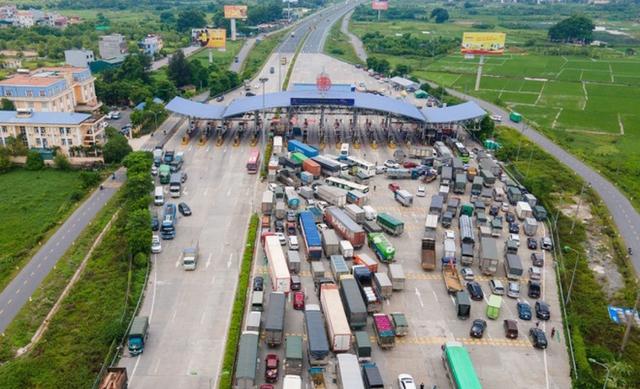 Chính phủ gỡ lưu thông hàng hóa, không kiểm tra xe chở hàng có QR Code từ 0h ngày 30/7  - Ảnh 1.