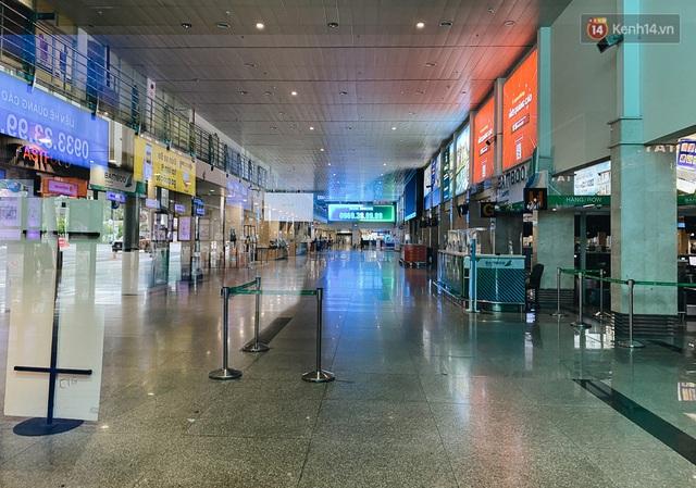 Cận cảnh sân bay Tân Sơn Nhất đìu hiu, vắng lặng chưa từng có khi dịch Covid-19 bùng phát lần thứ 4 - Ảnh 4.