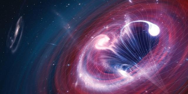 Lần đầu tiên trong lịch sử, các nhà khoa học nhìn thấy ánh sáng phát ra từ hố đen, một lần nữa Einstein lại đúng - Ảnh 1.
