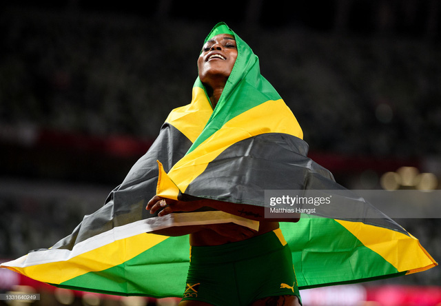 Nữ hoàng tốc độ Jamaica lấy bình luận tiêu cực làm năng lượng, phá kỷ lục 33 năm của điền kinh Olympic - Ảnh 4.