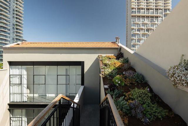 Biến nhà hoang thành nơi nghỉ dưỡng sang chảnh nhờ tường khung thép - Ảnh 20.
