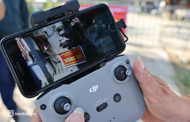 Ảnh: Cận cảnh địa phương đầu tiên tại Hà Nội sử dụng flycam giám sát người dân tại khu vực phong toả - Ảnh 4.