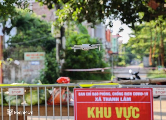 Ảnh: Cận cảnh địa phương đầu tiên tại Hà Nội sử dụng flycam giám sát người dân tại khu vực phong toả - Ảnh 6.