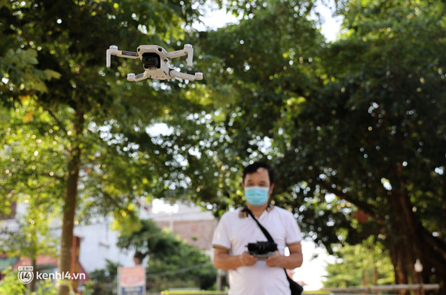 Ảnh: Cận cảnh địa phương đầu tiên tại Hà Nội sử dụng flycam giám sát người dân tại khu vực phong toả - Ảnh 7.