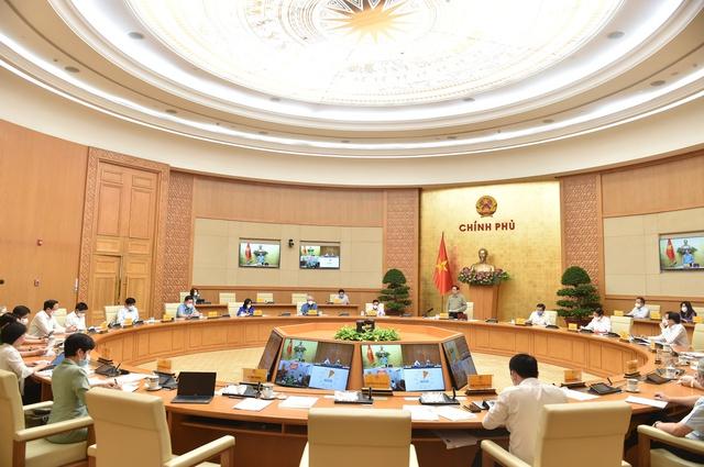 Thủ tướng nêu 6 nguyên tắc để sống chung với Covid-19 - Ảnh 1.