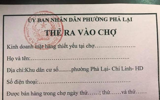 Người dân Chí Linh được phát thẻ đi chợ trong thời gian giãn cách