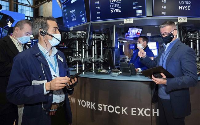 Hồi hộp chờ đợi số liệu kinh tế và phát biểu của Fed, Phố Wall giao dịch trong ảm đạm