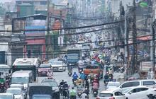"""Ảnh: Cận cảnh tuyến phố """"mạng nhện tử thần"""" khiến người đi đường thót tim ở Hà Nội"""