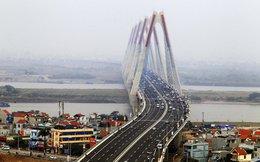 Tháo dỡ hơn 1.000m dải phân cách đường dẫn hai đầu cầu Nhật Tân