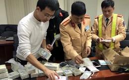 Thu giữ hàng trăm điện thoại iPhone nhập lậu trên xe ô tô mang biển số giả