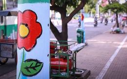 """Người dân thích thú khi hơn 100 cột điện, cột đèn ở Sài Gòn bỗng """"nở hoa"""""""