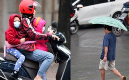Chùm ảnh: Hà Nội giảm nhiệt độ, người mặc áo khoác dày, người quần đùi áo cộc xuống phố