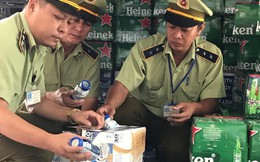Thu giữ hơn 7 ngàn chai bia Heineken và 15 ngàn chai sữa Ensure có dấu hiệu vi phạm về an toàn thực phẩm