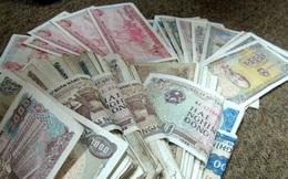 Người dân e ngại lây nhiễm bệnh khi giao dịch bằng tiền mặt