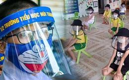 Phụ huynh tranh luận khi học sinh đeo tấm chắn giọt bắn trong lớp học: Người ủng hộ vì hạn chế nguy cơ nhiễm bệnh, người lại thương các con khó chịu, hại mắt