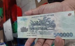 Kiên Giang: Điều tra đối tượng dùng tiền giả đi chợ mua hàng