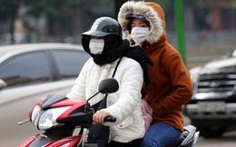 Rét đầu đông, dân Hà Nội kín mít đi làm, Hồ Tây vắng bóng người qua lại