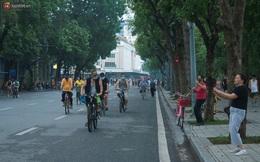 Ảnh: Người dân Thủ đô phấn khởi ra khỏi nhà từ sáng sớm để tập thể dục trở lại sau quy định mới