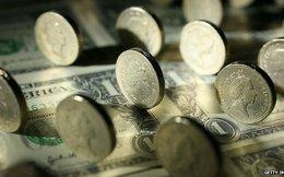 [Kinh tế thế giới 12/11] Năm ngân hàng bị phạt nặng vì thao túng tỷ giá