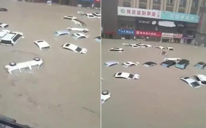 Ô tô trôi như thuyền giấy trong nước lũ tại Trung Quốc